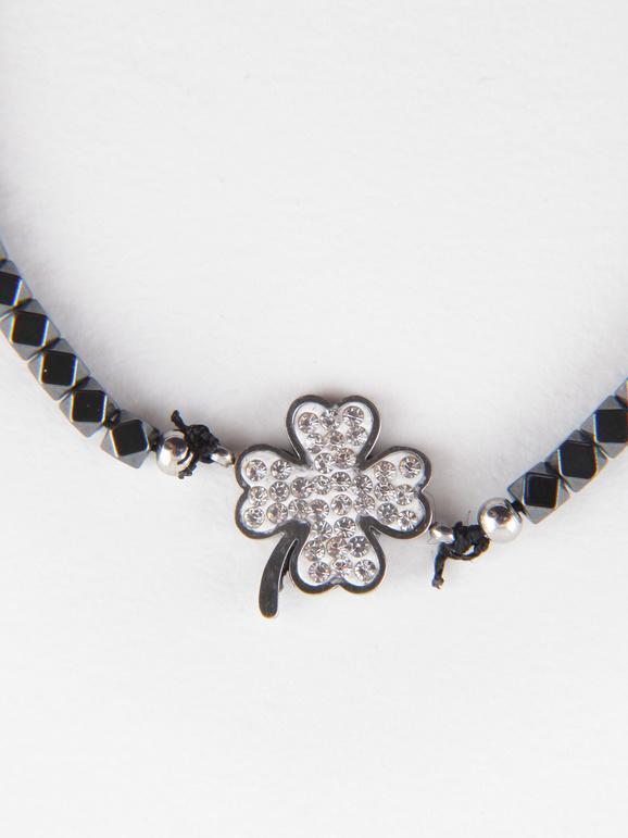 Bracelet avec trèfle à quatre feuilles et strass
