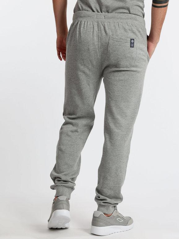 Pantaloni felpati con polsini