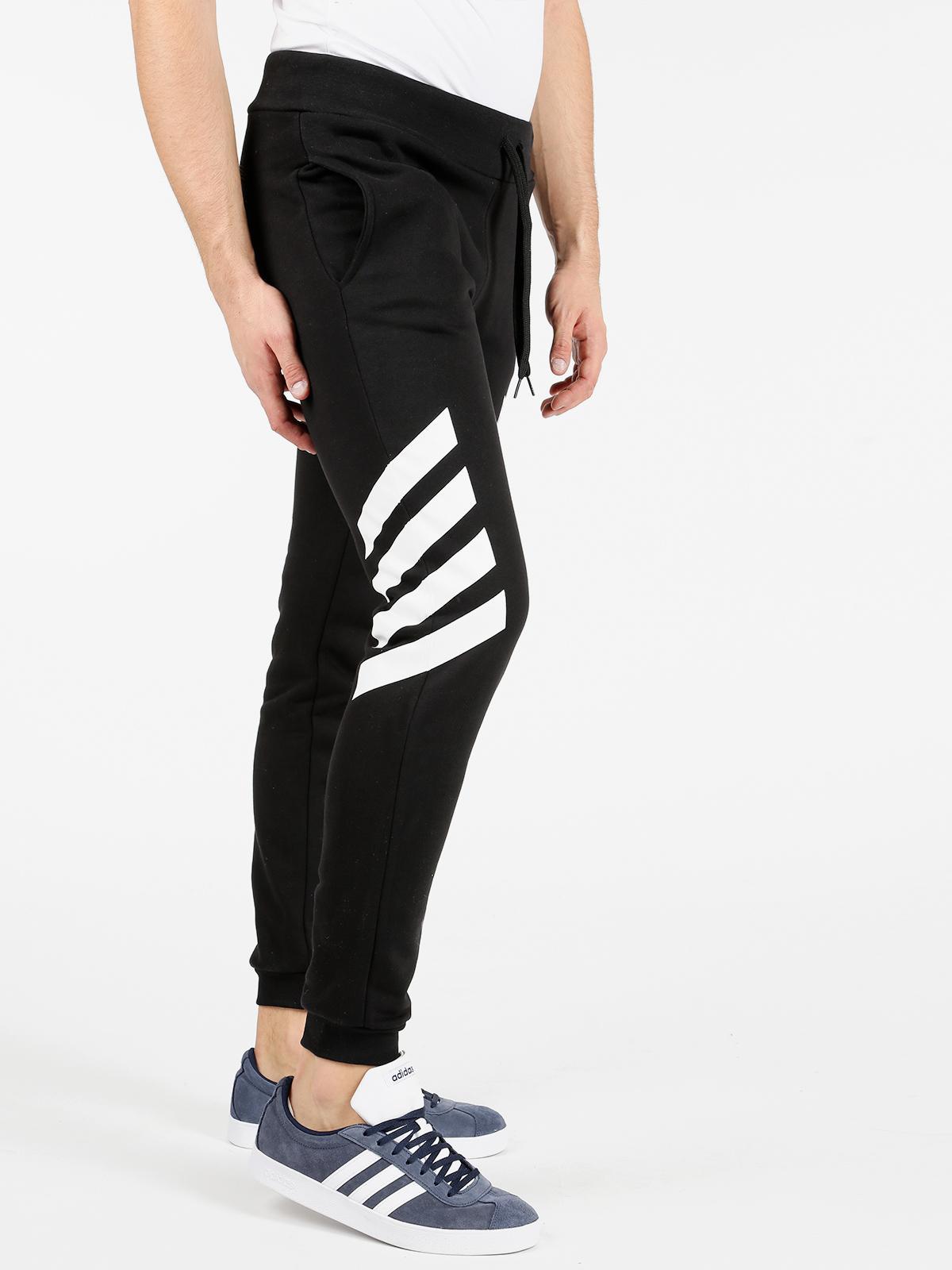 pantaloni adidas con polsini