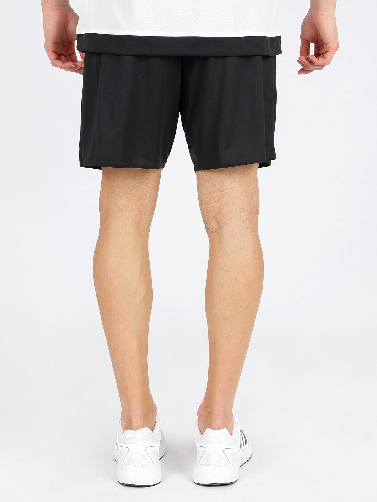uomo nero and bianca adidas shorts